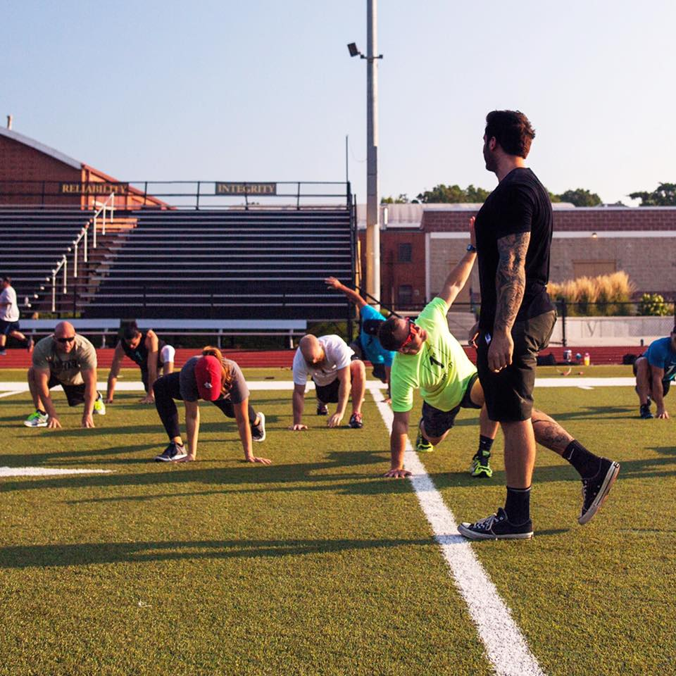 Men Exercising on a Football Field